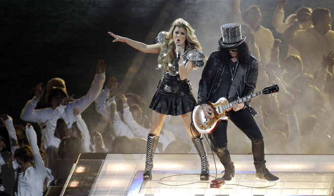 Fergie, left, of the Black Eyed Peas performs during half time of Super Bowl XLV with the The Green Bay Packers and the Pittsburgh Steelers in Arlington, Texas, Sunday, February 6, 2011. Photo by Benny.